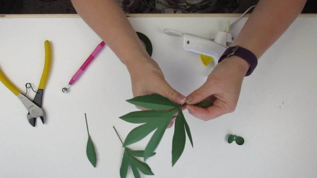 wrapping tape around the leaves