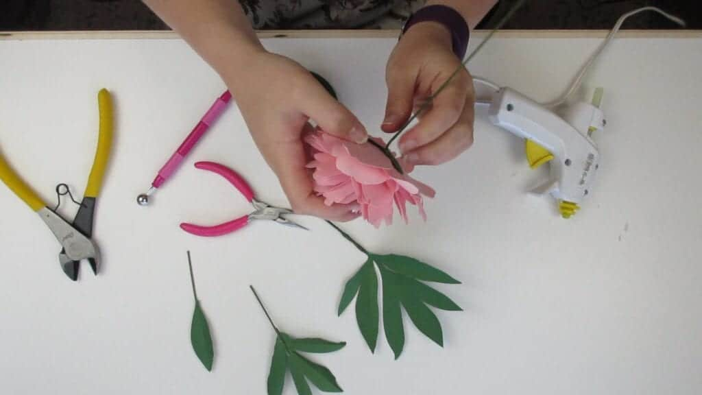 gluing the paper peony onto the stem