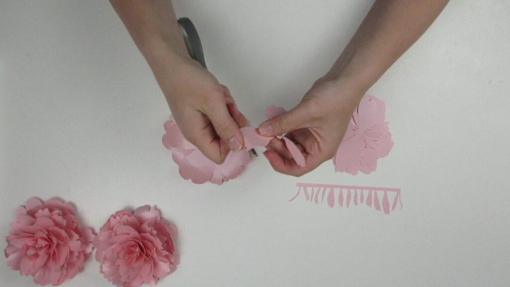 Curling the petals of the paper peony with scissors