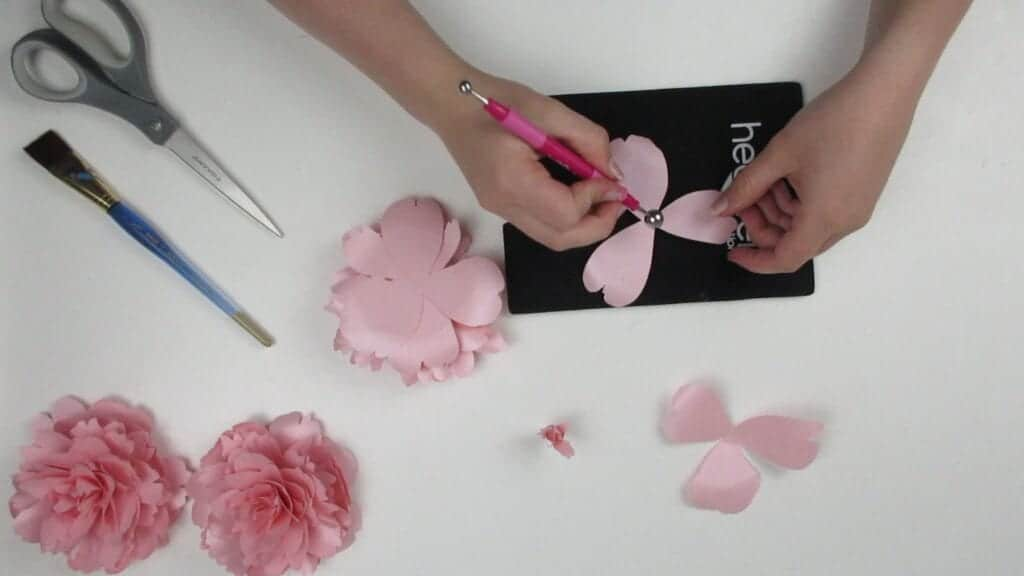 giving the petals of the paper peony some shape with a shaping mat